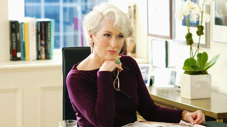 meryl streep sitting in office